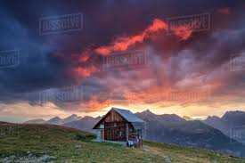 100 Muottas Muragl Wooden Hut Framed By Fiery Sky And Clouds At Sunset