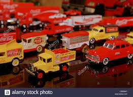 100 Toy Cars And Trucks A Collection Of Toy Cars And Trucks Carrying CocaCola Branding And