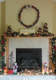 Rustic Christmas Fireplace With Twig Tree Pinecones And Deer On Mantel