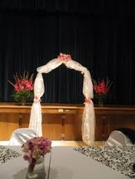 The Wedding Arch Was Decorated For A Beautiful Ceremony