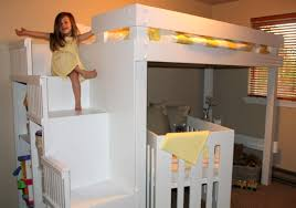 white kids bunk bed with baby crib underneath and stairs plus open