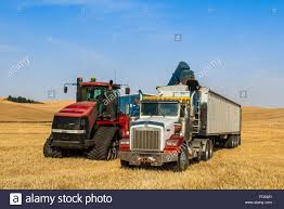 100 Eastern Truck And Trailer Grain Cart Unloading Wheat Into A Grain Truck In The Palouse Region