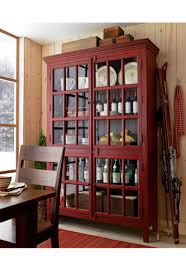 Tall Red Divided Cabinet With Four Paned Glass Doors Family Room Nook