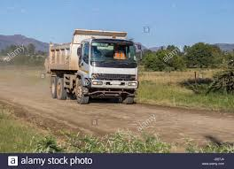 White Construction Truck Moving Fast With Load Of Rock And Sand On ... Wooden Tipping Sand Truck By Legler A Mouse With A House Tearin It Up In The Sand Chevy Obsession Pinterest Cars 4x4 Toy Truck Stock Photo Image Of Outdoor Seashore 10526362 Black Rhino Armory Wheels Desert Rims 2017 Ram 1500 Rebel Mojave Limited Edition Photo Gallery Boston And Gravel Of Unloading Earthworks Remediation Frac Transportation Land Movers Buy Digger Free Wheel Online In India Kheliya Toys Off Road Classifieds Superlite
