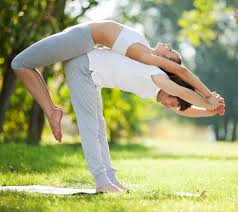 Couple Yoga Man And Woman Doing Exercises In The Park Advanced Professionals