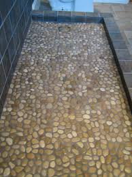Tile Flooring Ideas For Bathroom by 31 Great Ideas And Pictures Of River Rock Tiles For The Bathroom