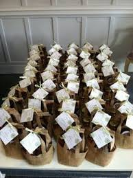 Rustic Burlap Bags Filled With Evening Snacks For Rehearsal Dinner Favors