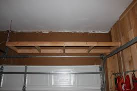Building Wood Shelves For Garage Attached To Studs by Shelves Over The Garage Door The Cavender Diary