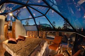 Watch the Northern Lights from Glass Igloos at Hotel Kakslauttanen