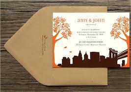 Chic White Orange And Chocolate Brown Fall Wedding Invitations With City Skyline Design