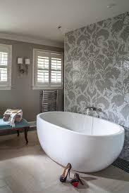 gray mosaic damask bathroom tiles with modern tub transitional