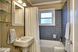 modern full bathroom with tiled shower crown molding in seattle