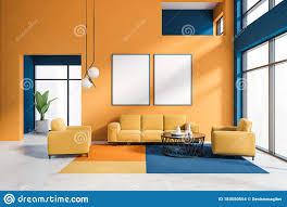orange und blaues wohnzimmer mit plakatgalerie stock