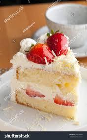 Slice of strawberry shortcake with white chocolate shavings