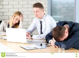 Boring Work Young Business People Looking Bored While Sitting Together At The Table And Away