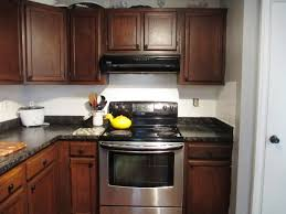 Stunning Wooden Kitchen Cabinet Using Java Gel Stain With Dark Countertop And Stove For Decor