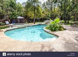 Kidney Shaped Swimming Pool And Hot Tub In Landscaped Backyard ... Hot Tub Patio Deck Plans Decoration Ideas Sexy Tubs And Spas Backyard Hot Tubs Extraordinary Amazing With Stone Masons Keys Spa Control Panel Home Outdoor Landscaping Images On Outstanding Fabulous For Decor Arrangement With Tub Patio Design Ideas Regard To Present Household Superb Part 7 Saunas Best Pinterest Diy Hottub Wood Pergola Wonderful Garden