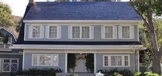 update tesla solar roof tile cost vs regular solar panels
