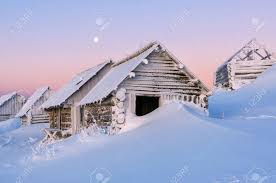 Abandoned Cabins In Snow Drift Winter Theme High Mountains Beautiful Sunrise Stock Photo