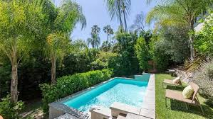 Swimming Pool With Palm Trees And Chairs - Best Swimming Pool ... Front Yard Landscaping With Palm Trees Faba Amys Office Photo Page Hgtv Design Ideas Backyard Designs Wood Above Concrete Wall And Outdoor Garden Exciting Tropical Pools Small Green Grasses Maintenance Backyards Cozy Plant Of The Week Florida Cstruction Landscape Palm Trees In Landscape Bing Images Horticulturejardinage Tree Types And Pictures From Of Houston Planting Sylvester Date Our Red Ostelinda Southern California History Species Guide Install