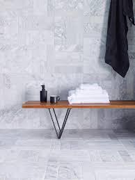 carrara honed marble tiles laid in a cool grid herringbone