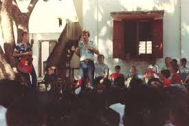 Tore Klevjer Speaks To A Seated Crowd Outside School In India
