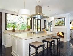 Kim Kardashians Kitchen With Dark Wood Floors Bar Stools White Pendant Lights And