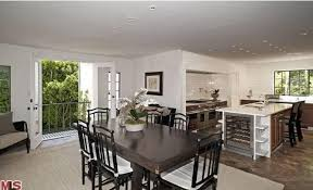 The Kitchen Features A Dine In Table Set With Classy Rug