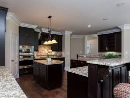 espresso cabinets with light granite countertops new home