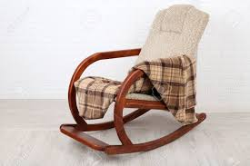 Rocking Chair Covered With Plaid On Wooden Floor Near The Brick.. Harvil Ergonomic Video Gaming Floor Rocker Chair Black Dedon Mbrace Summer Fniture That Rocks Bloomberg Red Rocking Upholstered With White Cloth In Front Of Brick Empty On Hardwood At Home Stock Photo 50 Pictures Hd Download Authentic Images On The Crew Classic Multiple Colors Walmartcom Wallpaper White And Brown Rocking Chair Near Kettal Vieques Screened Porch Woodlands Forest Cushion Set Oak Behr Premium 5 Gal Ppf40 1part Epoxy Satin Inexterior Concrete Garage Paint Solid Universal Recliner Mat Thick Rattan Cushions Seat Pillow For Tatami Outside Covers Patio