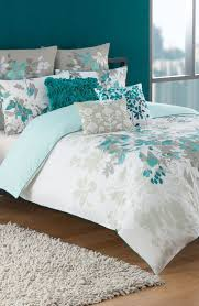 Teal Bedroom Ideas Medium Tone Hardwood Floors Built In Bed Bench Seat Faux Fireplace Floating Nightstand Gray Stained Wood Hanging Ceiling Lights Master
