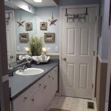 beach themed bathroom towels brown varnished wooden vanity cabinet