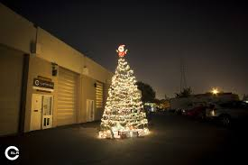 What Do You With 40 Camera Tripods 300 Ornaments 486 Feet Of Garland Lights And 1 Santa Build The Worlds Biggest Tripod Christmas Tree