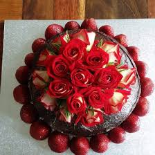 Egg & Dairy Free Chocolate Cake with Chocolate Icing Decorated with fresh roses and strawberries ApricotAlmondCardomomCake
