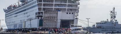Cruise Ship Sinking Now by Syrian Migrants Are Now Being Processed On A Cruise Ship In Greece
