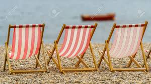 Empty Deck Chairs On A Pebble Beach Faced Towards The Sea With ... Marine Deck Chairs Vintage Wooden Thing The Garden And Patio Home Guide 15 Inspirational Best Folding Boat Chair Pics Rrealgenuinecom Stackable Outdoor Ding Chairs Bench Seating Deck Chair 10 Best Ipdent Deluxe Tangerine Outdoor And Tables Mum Dads Matching Deckchairs For Couples By Gillian Arnold Metal Tripinfo White Fniture Lounge Amazoncom Wise With Alinum Frame