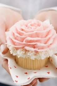 Pretty Pink Rose Cupcake With White Detailing