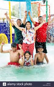 Happy Indian Family Waterpark Swimming Pool Bathing Enjoy