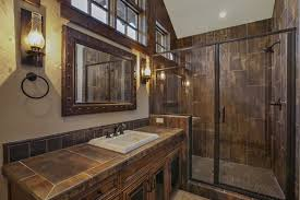 rustic bathroom with wood tiled shower and antique sink