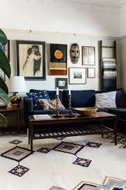 Its Impossible Not To Appreciate The Eclectic Mix Of Art On This Living Room Gallery Wall