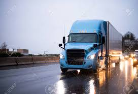 100 Semi Truck Pictures Modern Big Rig Blue With Covered Trailer Driving