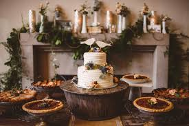 A Rustic Whimsical Dessert Table Featuring Buttercream Wedding Cake And Assorted Pies Venue
