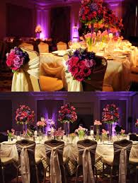 pink and purple arrangements and details on banquet style wedding