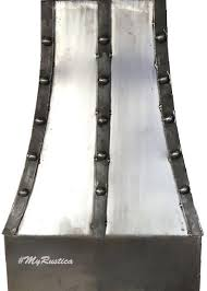 Industrial Style Range Hood Made Of Wrought Iron Decorated With Rustic Straps And Apron Designed