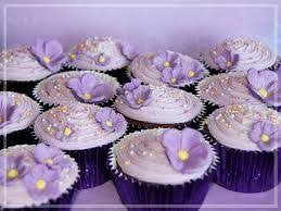 Chocolate cupcakes with purple icing sprinkles and shimmery purple blossoms for my niece s birthday