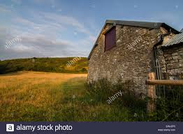 Farm Stone Barn With Loft Doors In Field Stock Photo, Royalty Free ... Traditional Farm Stone Barn And House Yorkshire Dales National Old Stone Barn Free Stock Photo Public Domain Pictures Ancient Abandoned On Bodmin Moorl With The Whats In Store Farm At Barns 50 States Of Style Photos Images Alamy Historic Bar Harbor Maine Corrugated Iron Roof Walls Friday Photography Filley Odyssey Through Nebraska Road Awaits Watching Golf Log Cabins Home Facebook Cedar Bend Retreat Center Stonebarn
