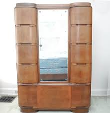 Mid-century Art Deco Armoire With Cedar Closet By Tri-Bond ... Emejing Armoire Art Deco Photos Transfmatorious Midcentury With Cedar Closet By Tribond Voyage Of An Kindredvoyages Sold Italian 1930s Vintage Wardrobe Or B491 Mahogany Cpactom Fitted Beautiful Burl Bakelite Handles At 1stdibs French Nouveau Maple And Inlaid Armoire Tanguy 1931 The Proteus Yves Pinterest Old World Complete In Warm Pomegranate English Faux Bamboo On Chairishcom Biscayne