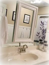 Small Guest Bathroom Decorating Ideas by Cool White Wooden Rectangle Mirror Frames Over White Single Sink