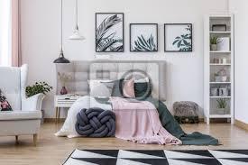 fototapete sessel im gemütlichen schlafzimmer