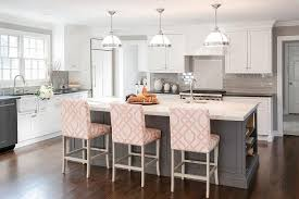 Gray KItchen Island With Pink Trellis Counter Stools